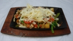 Fajitas Cozumel (Double - The best combination of chicken and pineapple you ever tasted. Grilled to perfection with onions, bell peppers and tomatoes. Topped with cheese and served with rice, beans, lettuce, guacamole, sour cream and pico de gallo.