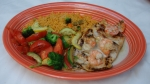 La Marina - Grilled chicken breast and shrimp topped with our new mushroom and cheese sauce. Served with rice and grilled vegetables.