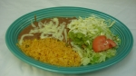 Chalupa  - A flat, crispy tortilla covered with beans, lettuce, cheese, tomatoes and guacamole. Served with rice and beans.