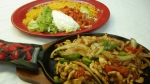 6 oz. Fajitas Lunch - Grilled steak or chicken with onions, peppers and tomatoes. Served with rice, beans, salad and tortillas.